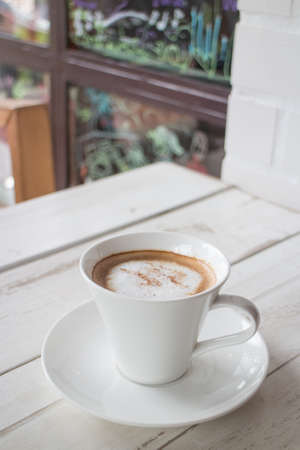 Coffee in a cup on a white wooden table Stock Photo