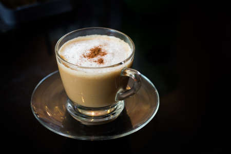 Coffee in a glass cup with black background Stock Photo