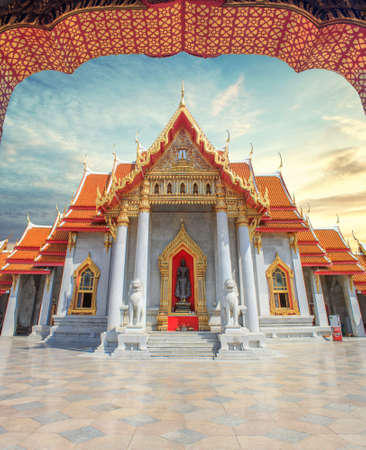 Famous marble Buddhist temple or Wat Benchamabophit in Bangkok, Thailand with sunset sky Stock Photo