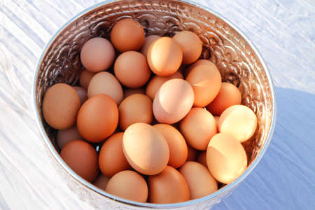 Eggs in a silver container Stock Photo