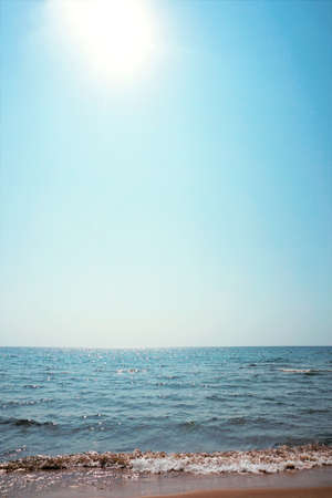Summer landscape on the sea and a blinding sun with a blue sky, picture, wallpaper.
