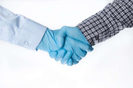 Handshake in gloves. epidemic 2020. coronavirus. the fight versus the virus. pandemic. covid-19