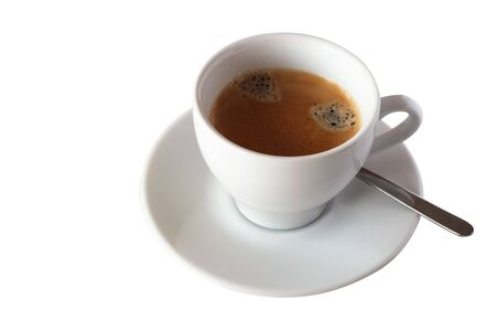 Delicious cup of coffee in a white cup and saucer with a spoon. Includes clipping path.