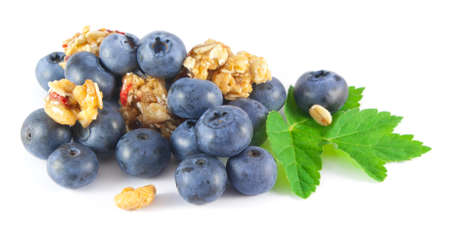 chunks: Blueberries with honey roasted cereal chunks on white background Stock Photo