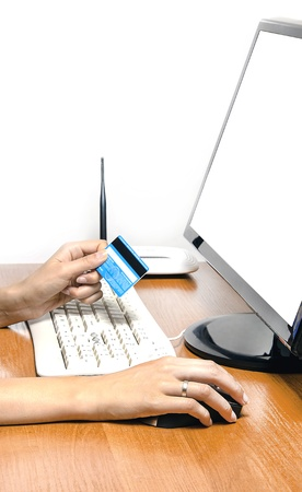 entering information: Credit card in hand to pay for internet