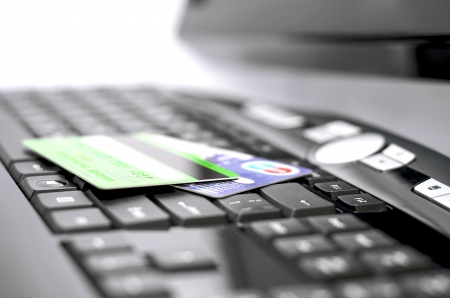 Close up of credit cards on a keyboard photo