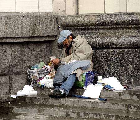 Beggar is begging for food on the street Editorial