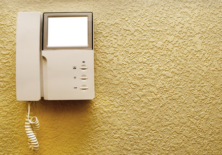 Security set with intercom over new stucco wall Stock Photo