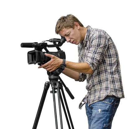 Video camera operator working with his professional equipment isolated on white background Stock Photo - 22608222