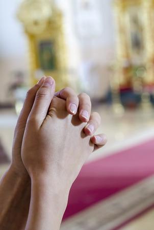 Hands crossed in prayer