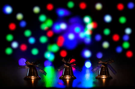 Christmas bells against defocused background with shallow depth of field  Stock Photo