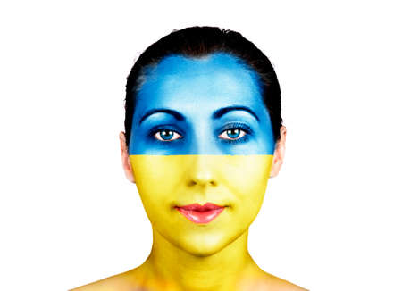 Face of a woman with the Ukraine flag   photo