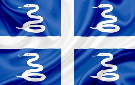 martinique: Bandera de Martinica ondeando en el viento