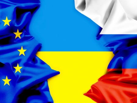 Flags of Ukraine, the European Union and Russia  Conflict  Stock Photo
