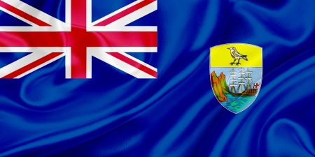 ascension: Flag of Saint Helena, Ascension and Tristan da Cunha waving in the wind Stock Photo