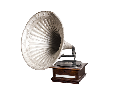 Retro old gramophone with horn speaker for playing music over plates isolated on white Stock Photo