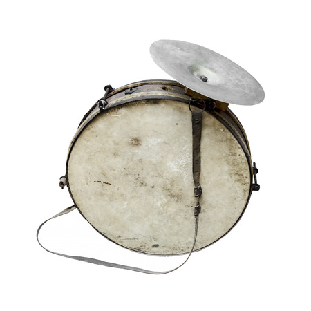 The old, worldly-wise, shabby, dusty bass drum for a wind band and a beater Stock Photo