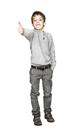 Portrait of happy boy showing thumbs up gesture, isolated over white background photo