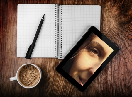 Tablet with a photo of a beautiful girl photo