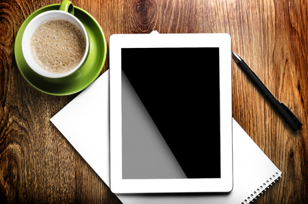 Tablet pc, pen and green cup  photo