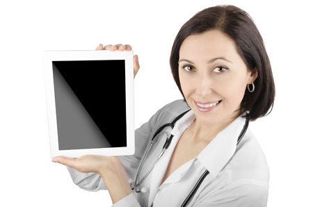 Female doctor with tablet computer isolated on a white background photo
