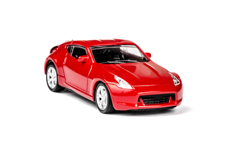 Red Toy Car on a white background photo