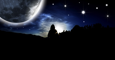 somebody: Starry Sky. Mystical figure in the rays of moonlight. Stock Photo