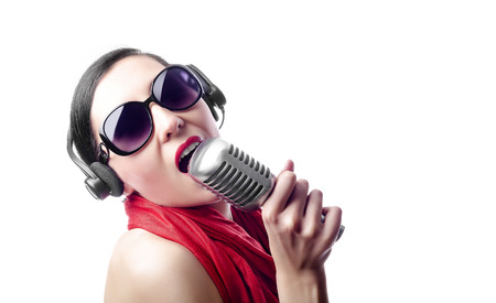 brune: Beautiful girl in the red with microphone Stock Photo