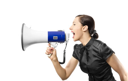 Woman screaming on a megaphon, isolated over white photo
