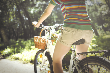 Legs of a beautiful woman on a bicycle photo
