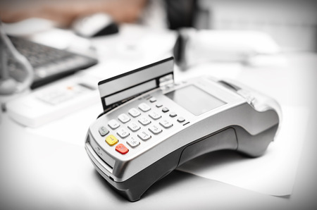 Bank terminal and payment card on the office table photo
