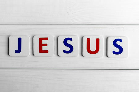 jesus word: Jesus word composed of letters on a background of wood Stock Photo