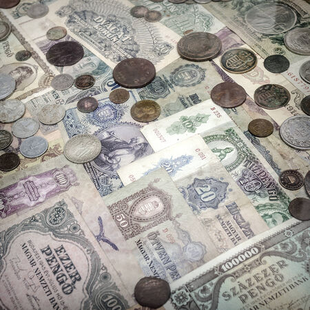 numismatist: Old money, paper and coins. Abstract background.