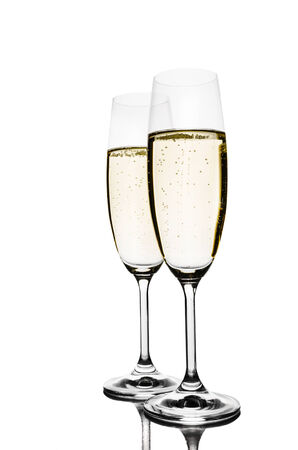 Two glasses of champagne. Isolated on white photo