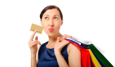 Shopping woman holding shopping bags and credit card photo