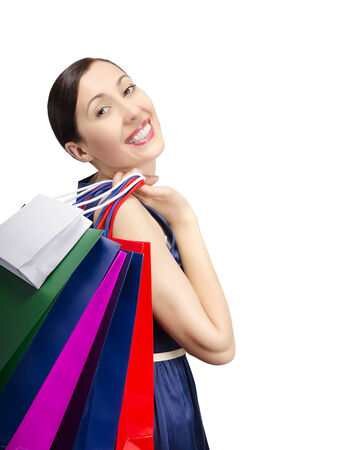 Woman holding shopping bags. Isolated on white. Stock Photo - 29942123