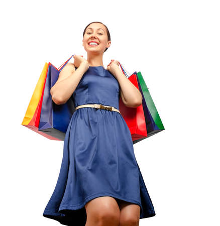 Shopping woman holding shopping bags. Isolated on white. Stock Photo - 29942124