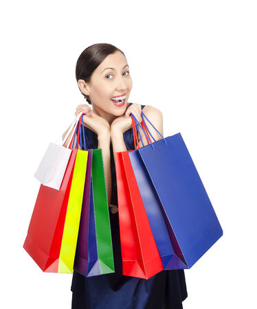 Shopping woman holding shopping bags. Isolated on white. Stock Photo - 29942125
