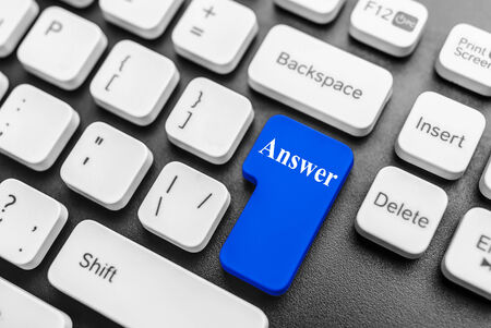 Large blue computer keyboard button with the word answer photo
