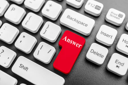 Large red computer keyboard button with the word answer photo