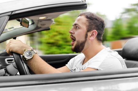 car driving: Fright face of man driving car and strongly hold the wheel