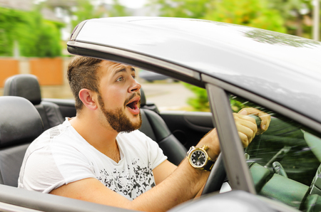 squeal: Fright face of man driving car and strongly hold the wheel