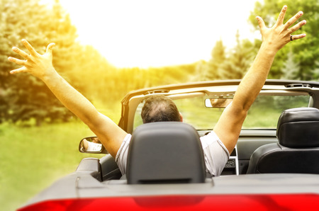 Freedom - Happy free man in the car