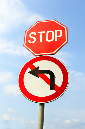 turn left sign: Stop Sign and Do Not Turn Left Sign