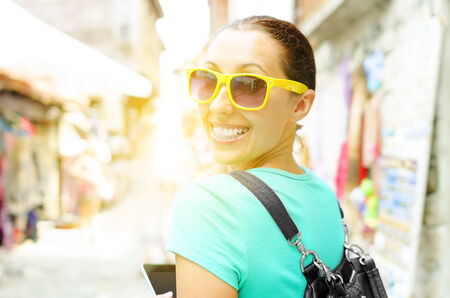Attractive girl tourist, smiling walking outdoors photo