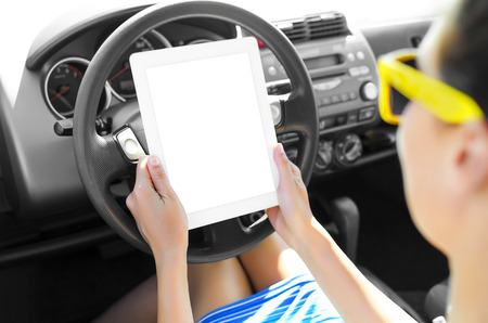 Woman in the car with tablet pc  photo