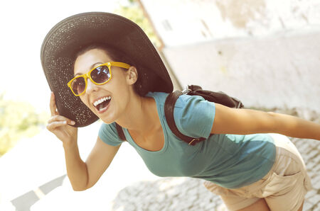 Girl laughs while standing in an awkward position photo