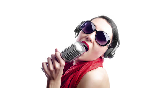 brune: Beautiful singer with microphone in black glasses