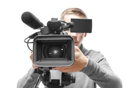 camara de cine: Operador de cámara de vídeo aislado en fondo blanco Foto de archivo