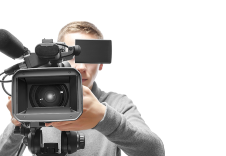 entertainment industry: Video camera operator isolated on white background Stock Photo